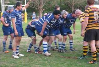 Rugby props in the front row preparing to form a scrum
