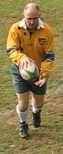 Bouncing grubber kick of a rugby ball starting position
