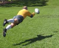 Player demonstrates an older style scrumhalf pass