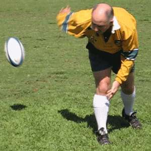 Reverse pass of a rugby ball showing finishing position