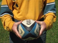 Player shows how to spin a rugby ball. Step 1.
