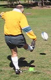 Toe place kick of a rugby ball finish position