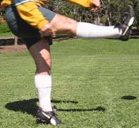 Up and under close-up, foot having struck the ball