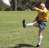 Player shows finishing position for Up and under kick