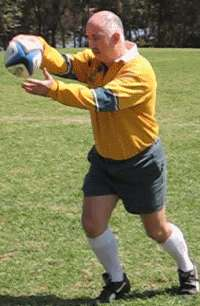 Player shows starting position for Up and under kick