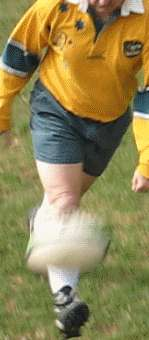 Chip kick of a rugby ball finishing position