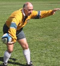 Flick pass of a rugby ball starting position