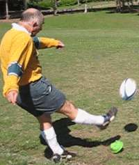 Instep place kick of a rugby ball finish position